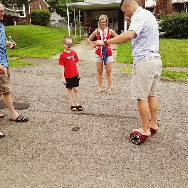 Fun at our Memorial Day family cookout My nephew brought his hover board thing to out family cook out today. Everyone was taking turns, trying not to kill themselves on it. Emmett took a turn as well and had a ton of fun...