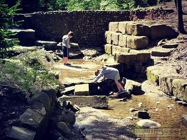 The boys exploring the creek at the Canton Garden Center.